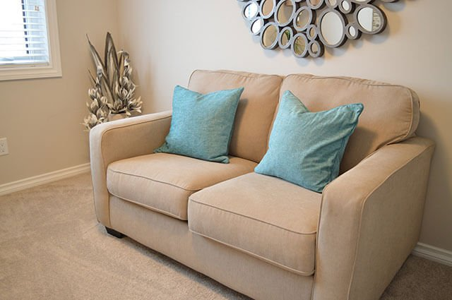 tan upholstery with blue pillows