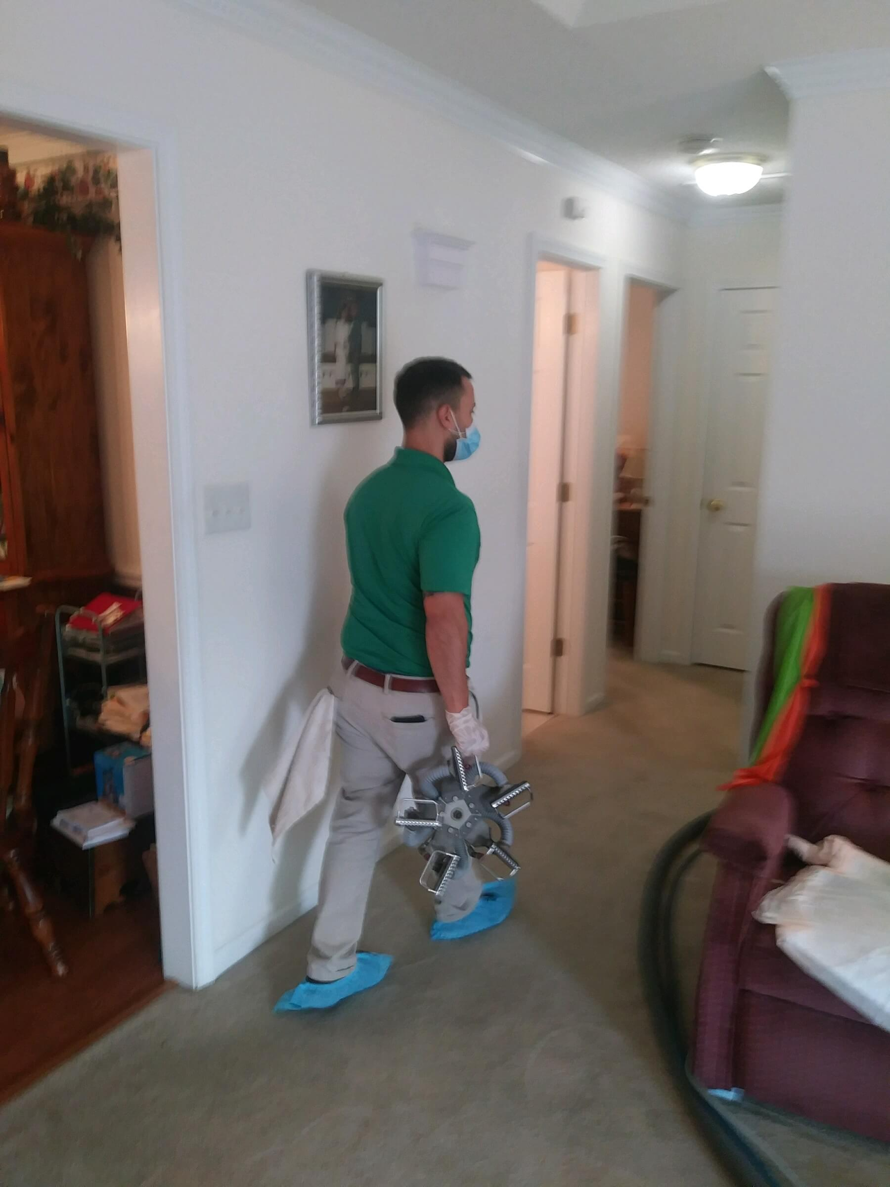 green team chem-dry tech performing carpet cleaning in central piedmont